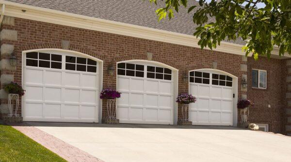 three white garage doors