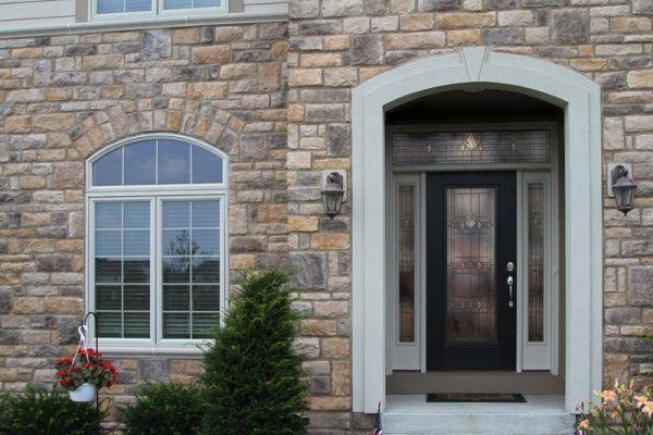 front porch with stone walls