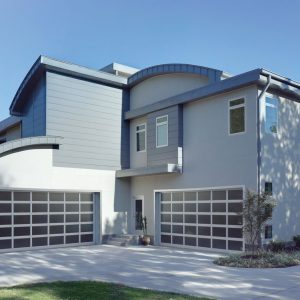large white and gray house with two garage doors