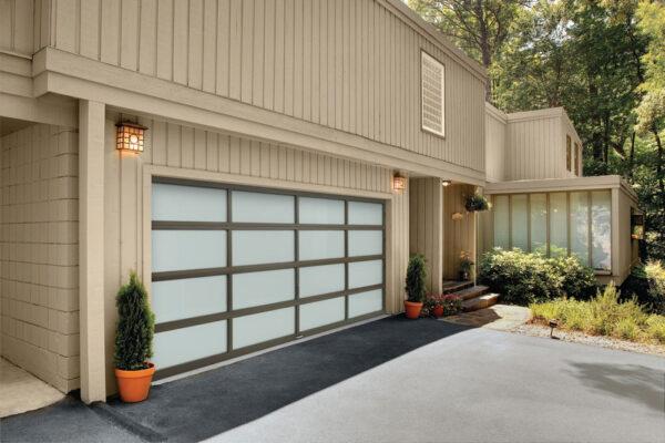 beige home with garage door