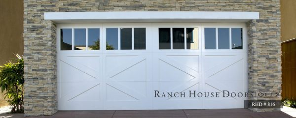 Large white barn style doors with small glass panels