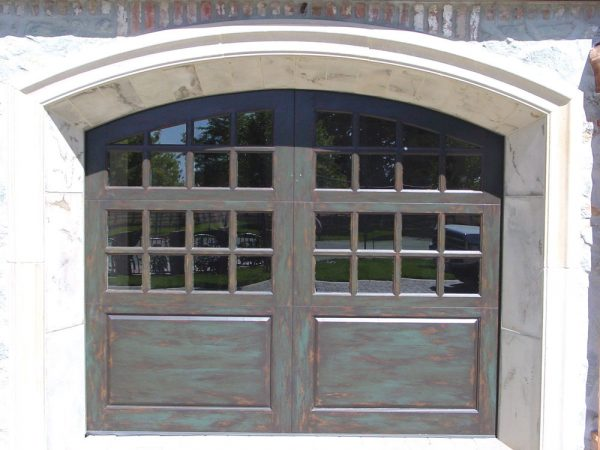 Arched carriage house door with glass