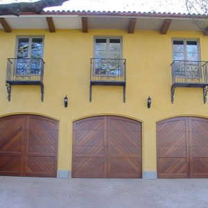 three arched wood carriage house doors