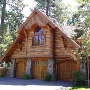 cabin style house with carriage house doors
