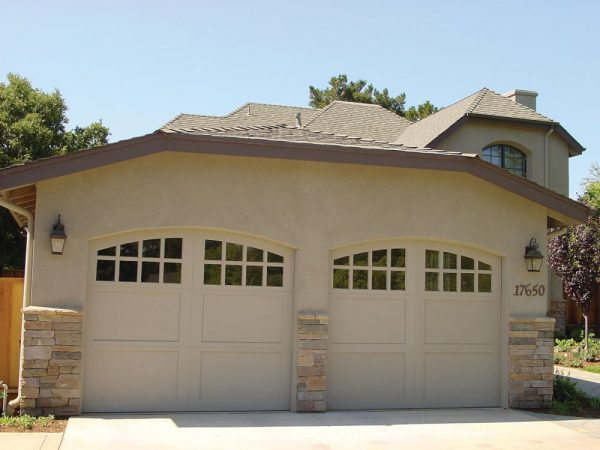 house exterior with carriage house doors
