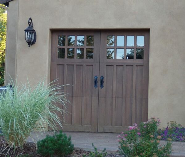 carriage house door with black metal handles