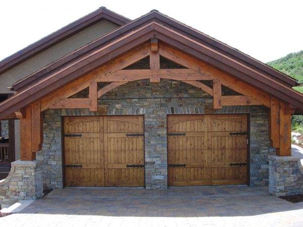 two carriage house doors on stone and wood structure
