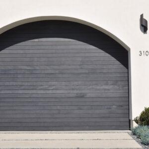 Arched dark wood design garage door