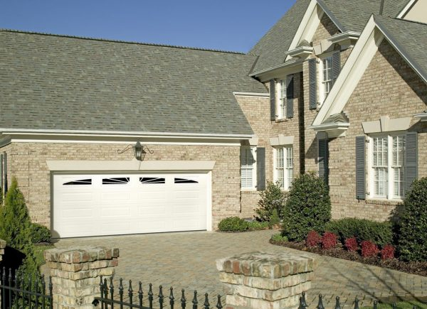 brick house with white garage doors