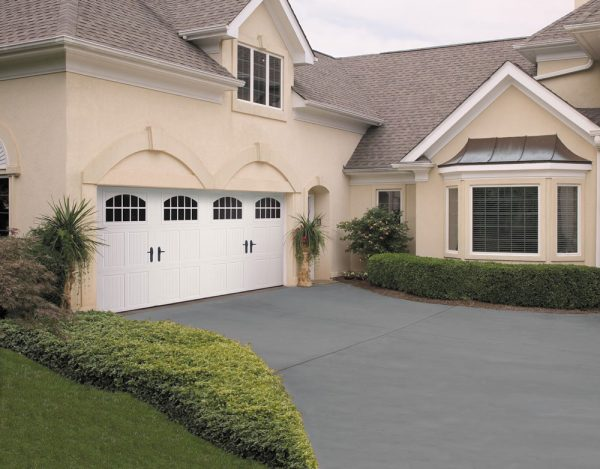 white garage doors and brown roof