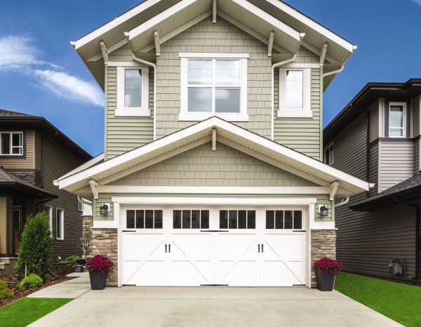 white 2 story house with double garage door