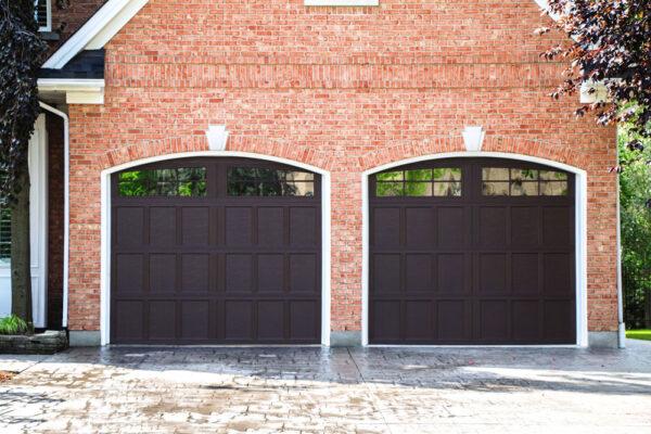 brick house with 2 garage doors