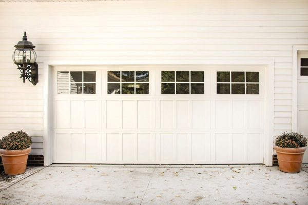 white house with white 2 car garage door