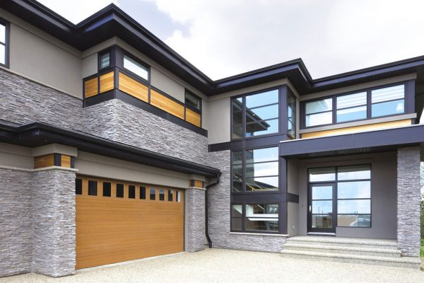 modern 2 story house with wooden garage door