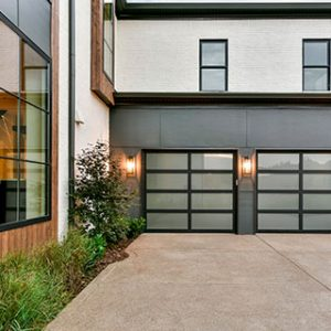 modern looking home with two garage doors