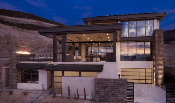 luxurious home with large glass windows
