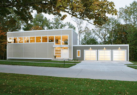 container freight home with three garage doors