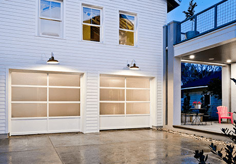 white garage doors by the driveway