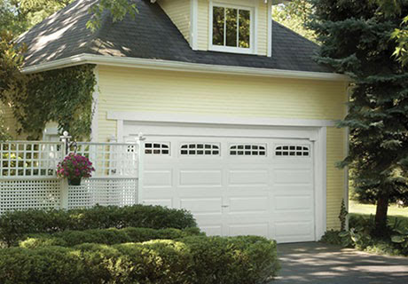 white garage door of a simple house