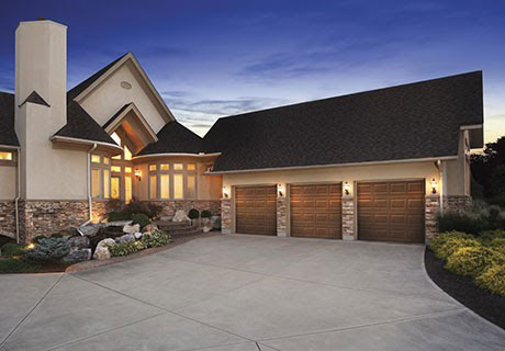 large house with large driveway and garage space