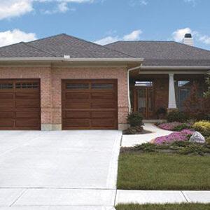 home with classic wooden garage doors