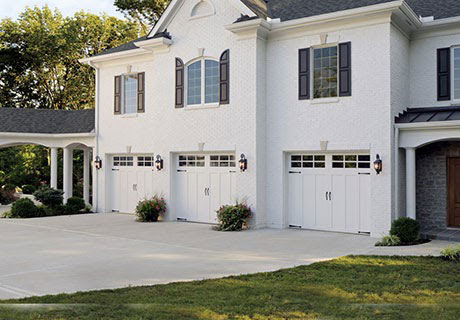 white house with large driveway