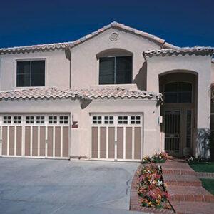 White home with beige garage doors