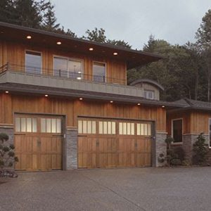 wooden house with large garage doors