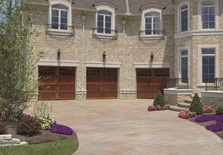 Large driveway with three garage doors