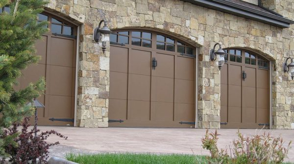 three sets of carriage house garage doors