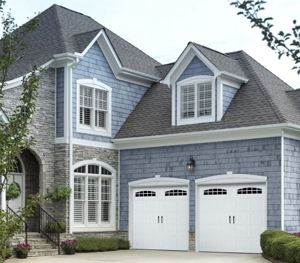 blue house exterior with two garage doors