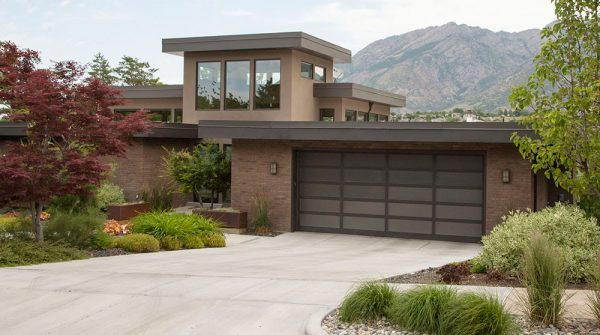 brown house with glass garage doors