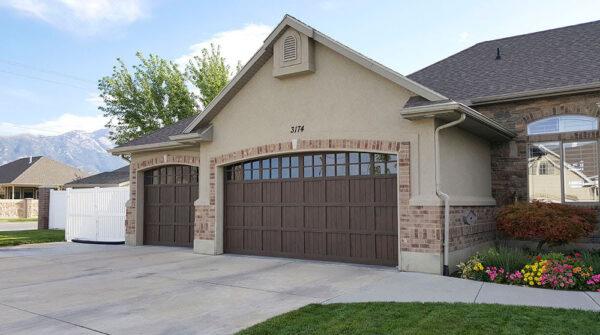 brick house with brown garage doors