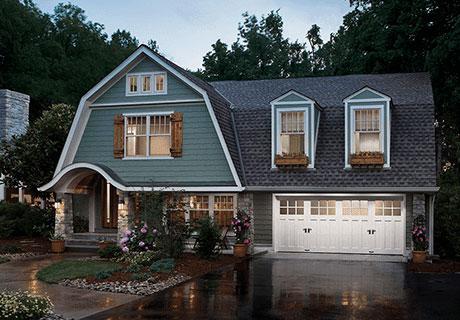 big house with white garage doors