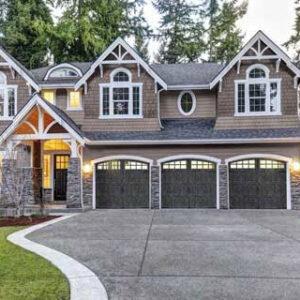 huge house with gray garage doors