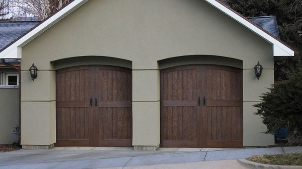 front view of house with wooden garage doors