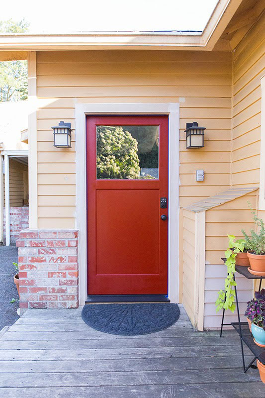 red front door with glass panel