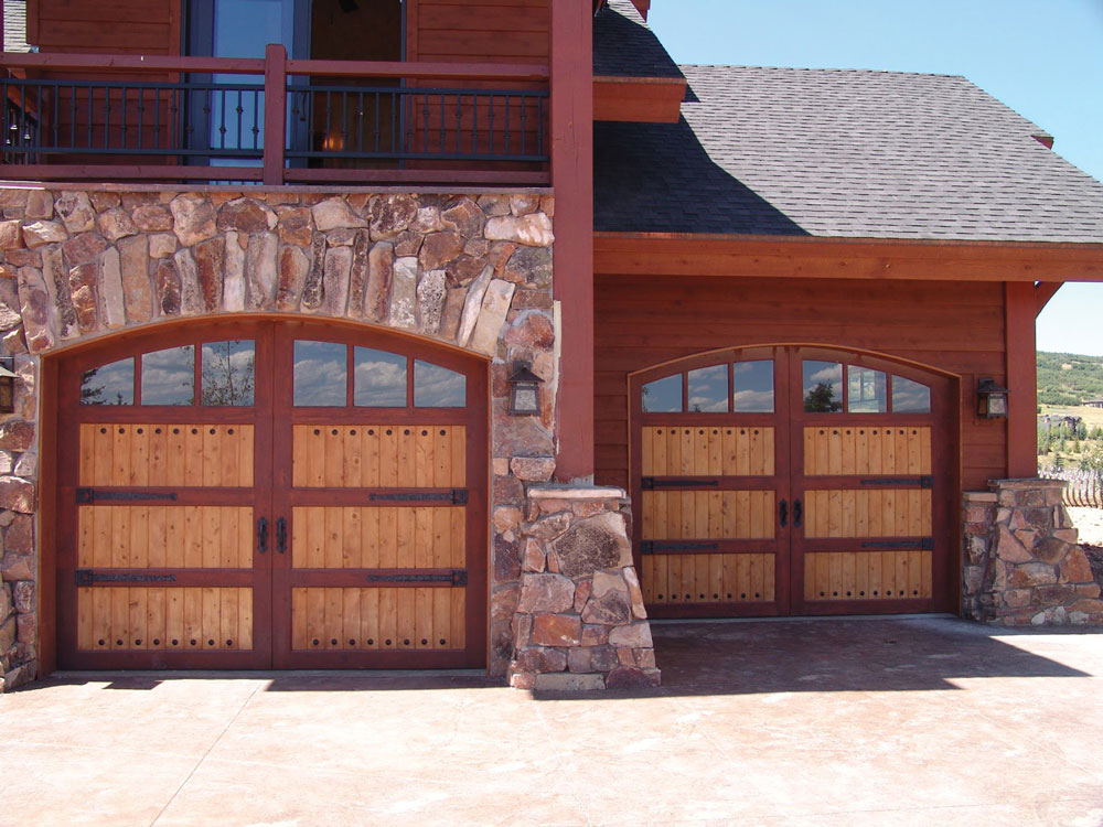 arched wooden carriage house doors