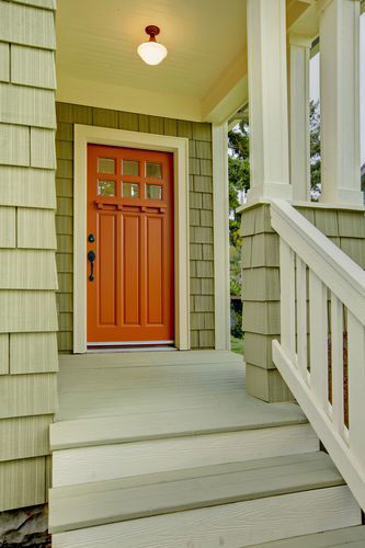 front porch with wooden door and light