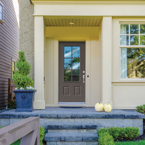 white home with timber gray door