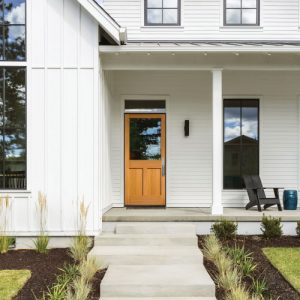 white house with single wooden door