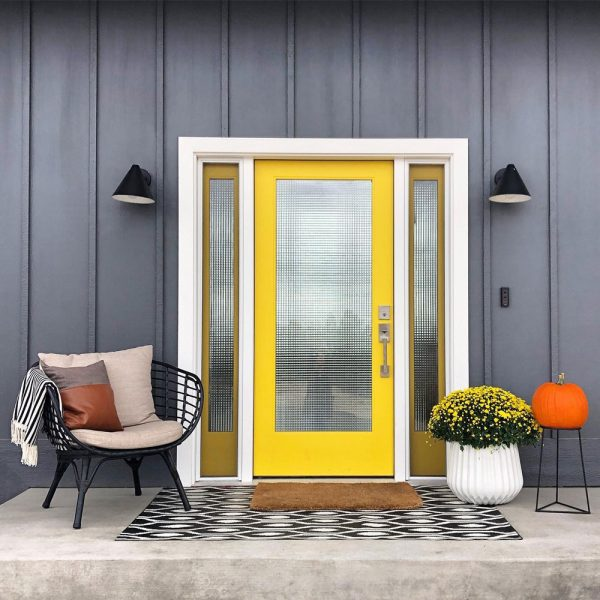 bright yellow and brown door with frosted glass panels