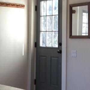 dark gray door with glass panel