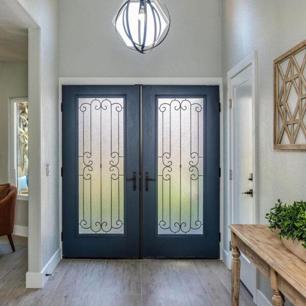 dark blue double doors with glass panels