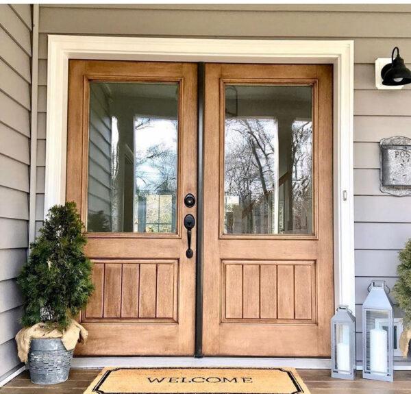 wooden front door with black door handle