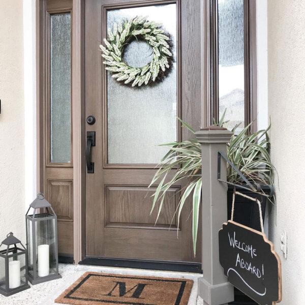 dark wooden door with christmas wreath