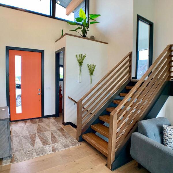 wooden stairs and orange door