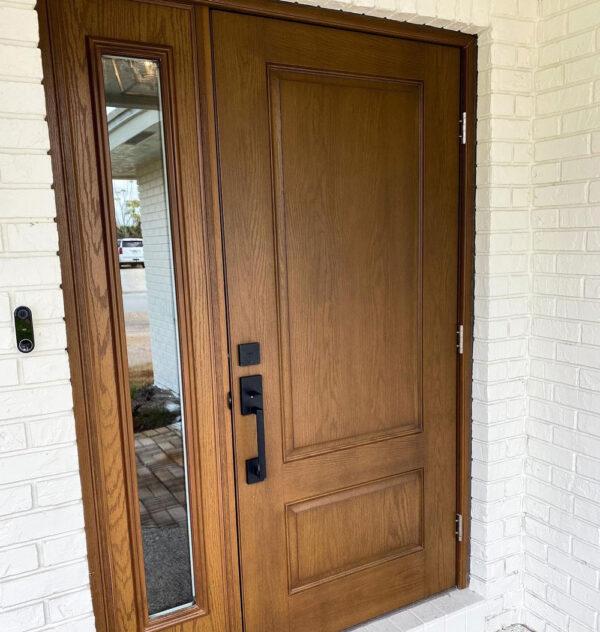 Wooden door with black knobs