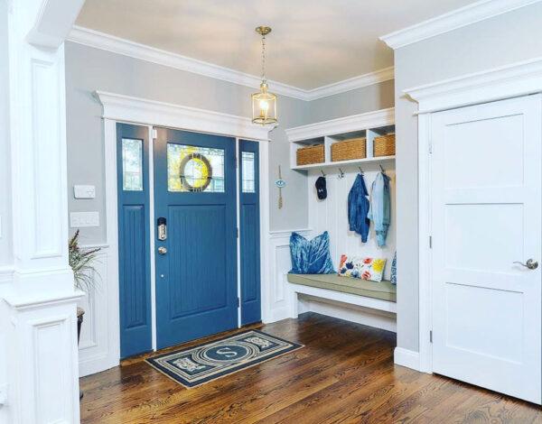 Ocean blue front door with small glass panels