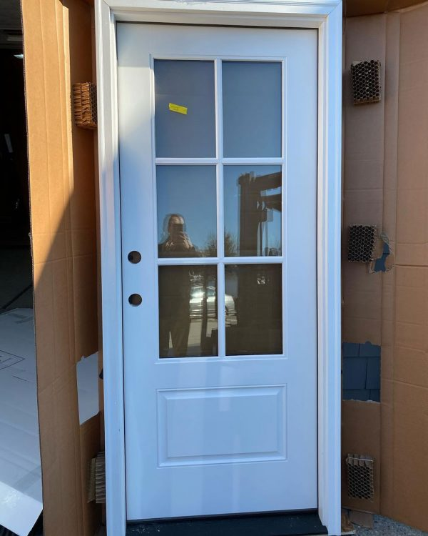 small white door with glass panels